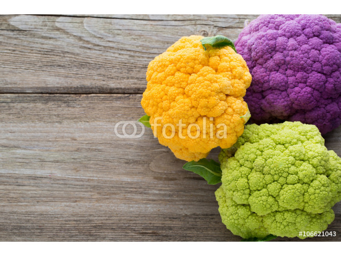 Rainbow of eco cauliflower on the wooden table. 64238