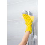 Woman cleaning a shower fixture 64238