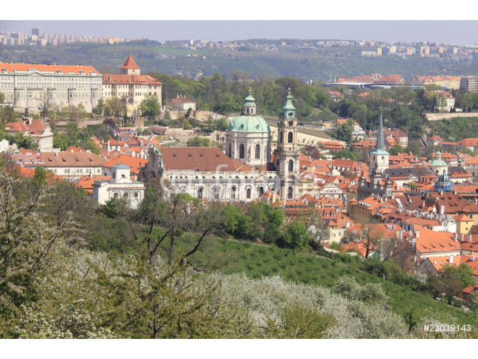 Prague's St. Nicholas' Cathedral with flowering trees 64238