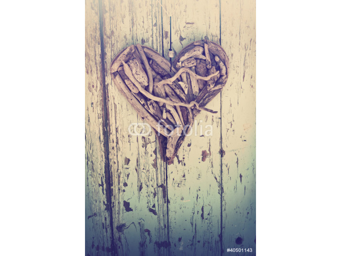 driftwood heart on vintage wall 64238