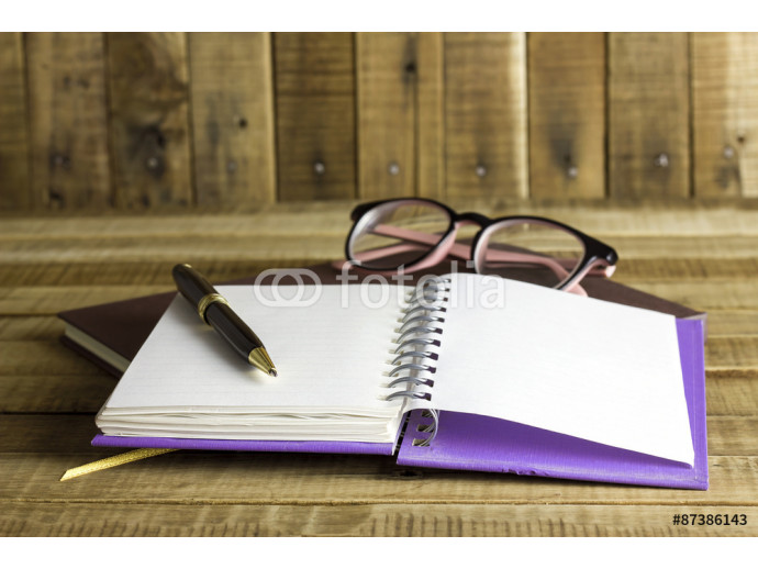 book with glasses and pen on the wooden background 64238