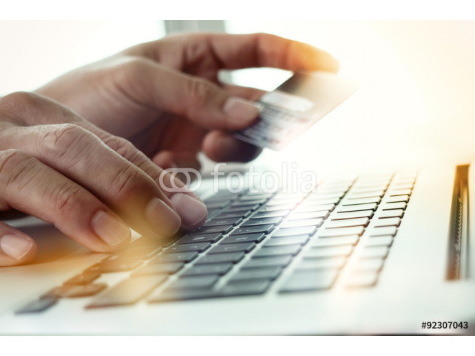 close up of hands using laptop and holding credit card  as Onlin 64238