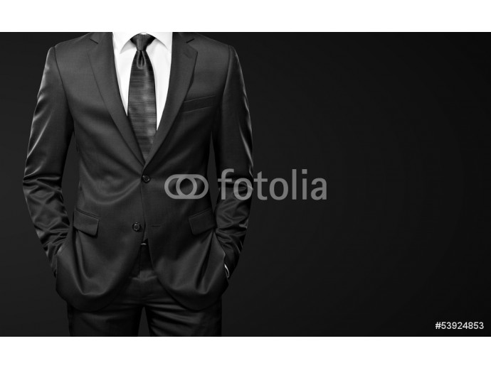 man in suit on black background 64238
