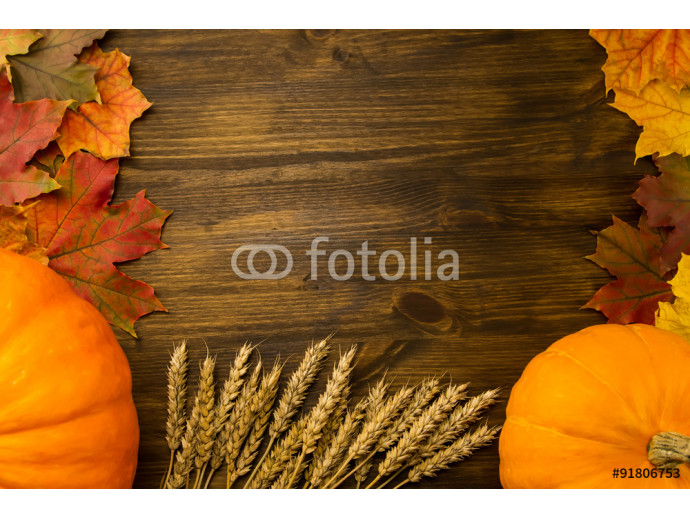 Yellow ripe pumpkin, maple leaves, red apples, wheat on wooden background. Thanksgiving, autumn, homemade. 64238