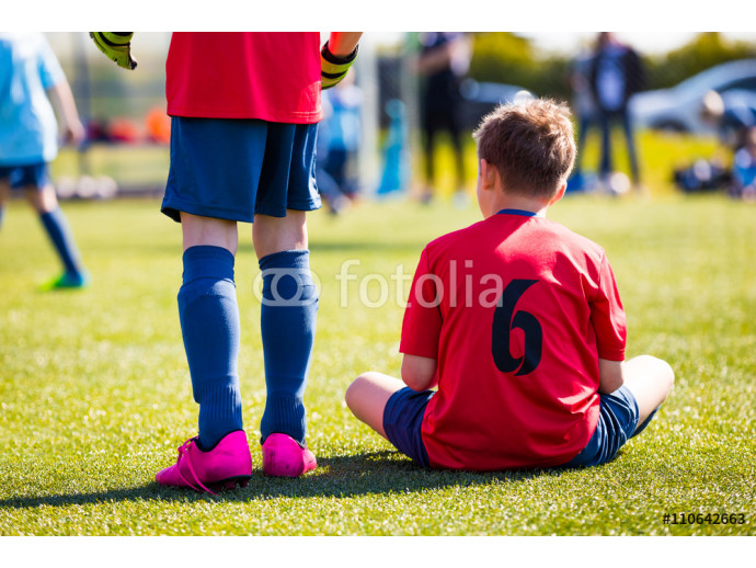 Youth Soccer Player sitting on sports venue. Football soccer tournament for young boys. 64238
