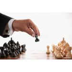 businessman playing chess game selective focus 64238