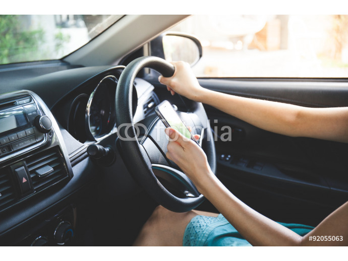 woman driver use her cell phone while driving. Vintage tone 64238