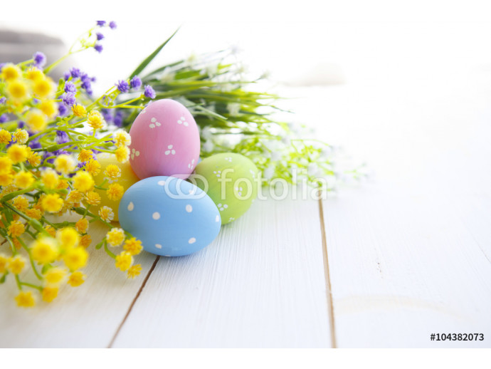 Colorful Easter eggs on wooden background. 64238