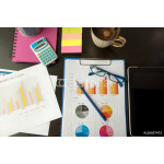 Working in office with Showing Hand Market Report Charts.Marketing Department Planning New Strategy.Researching Process Wood Table.Horizontal.Blurred Background.Film effect. 64238