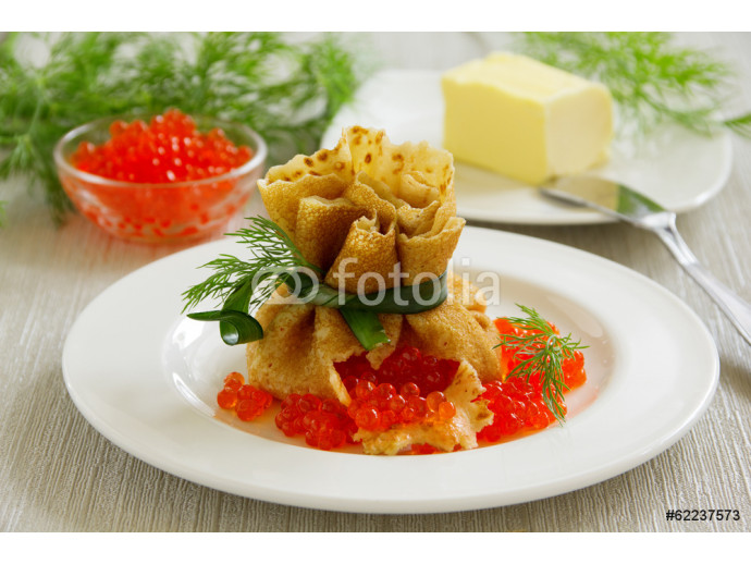 Traditional Russian pancakes with red caviar. 64238