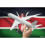 Airplane in hand with flag on background - Kenya 64238