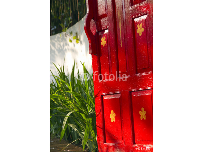 Bright red wooden gate leading to a lush garden 64238