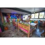 Bright colored bar-restaurant on the white sandy beach in Tulum 64238