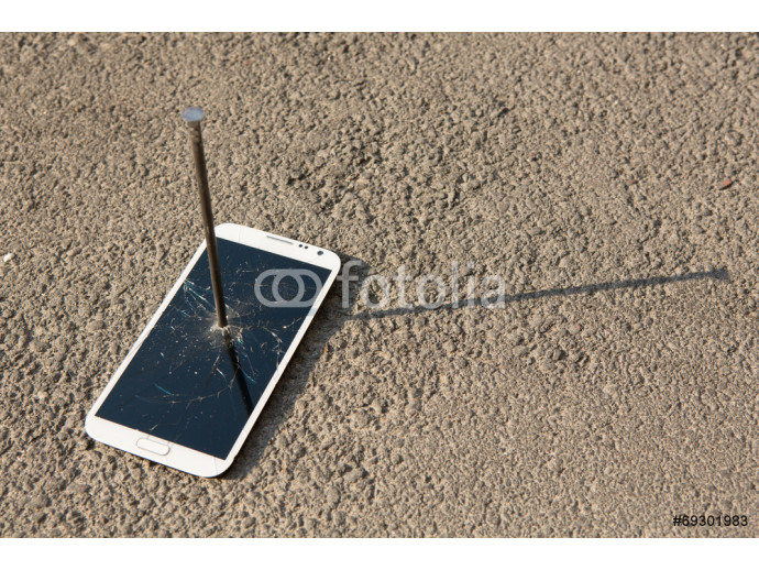Composition of metal nail and smartphone 64238
