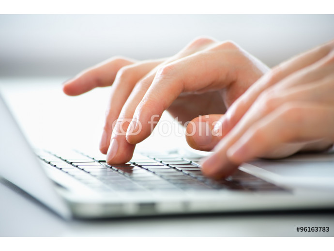 Close-up of hands of business man typing on a laptop. 64238