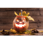 jack-o-lantern with leaves on wooden background 64238