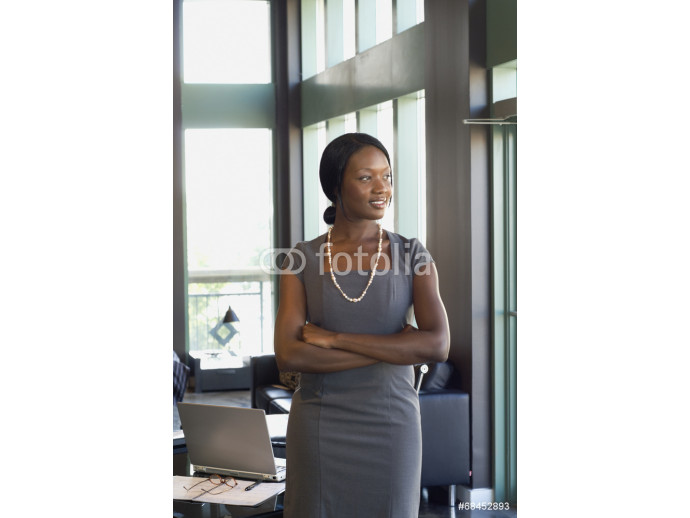 African businesswoman with arms crossed 64238