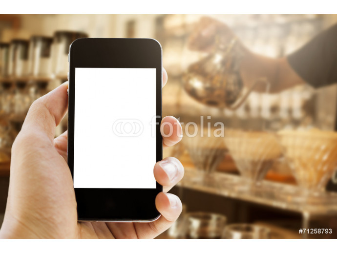 Fototapeta hand holding phone on coffee cafe  background 64238