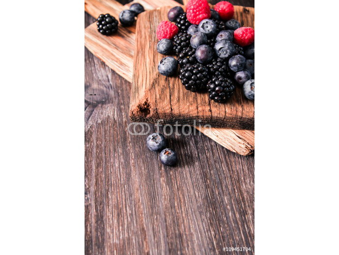 blueberries and raspberries on a wooden background 64238