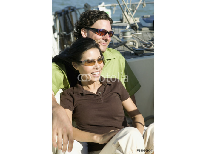 Portrait of couple on sailboat 64238