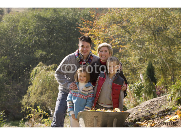 Portrait of family near wheelbarrow 64238