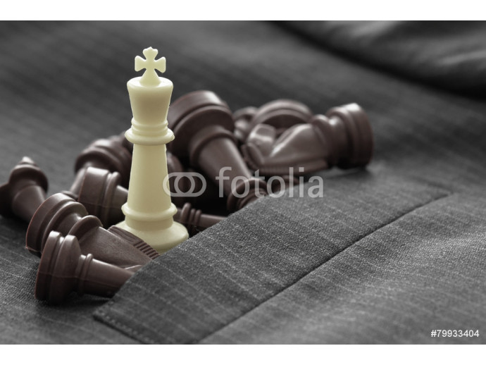 close up of chess figure on suit background strategy or leadersh 64238