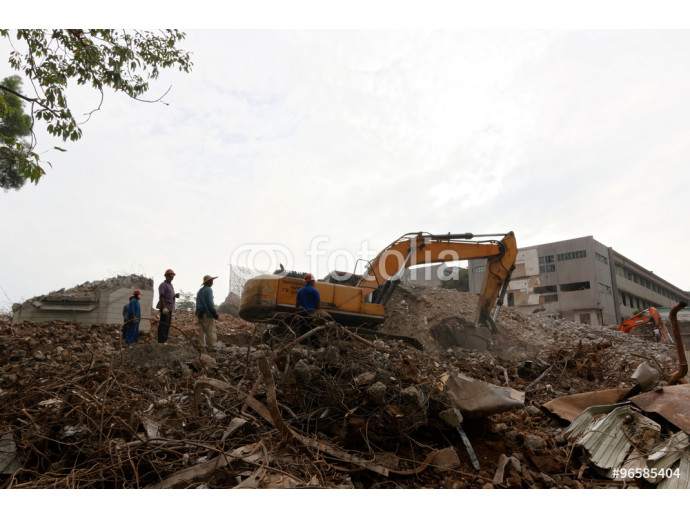 Building demolition site with excavator and workers 64238