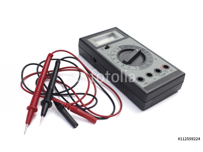 Digital multimeter with LCD display isolated on white background. Red and black wires.  64238