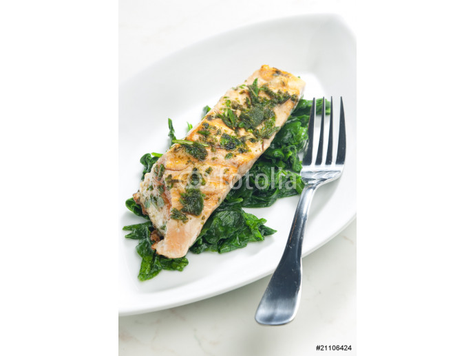 grilled salmon with herbs on fried spinach 64238