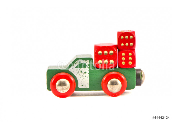 old truck toy with three red dice isolated on white 64238