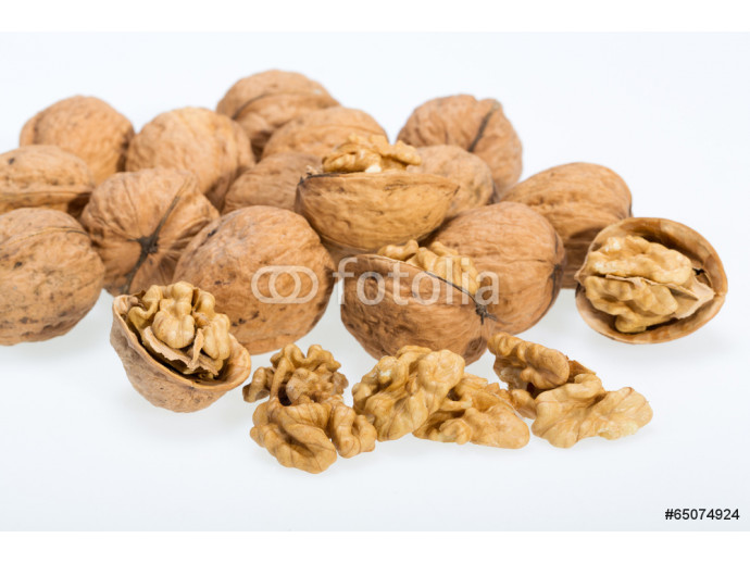 walnut and a cracked walnut isolated on the white background 64238