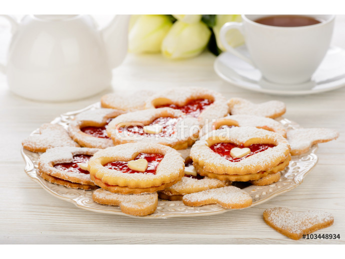 Shortbread cookies in the shape of heart with strawberry jam on wooden table. 64238