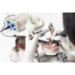 Dental technician working with articulator 64238