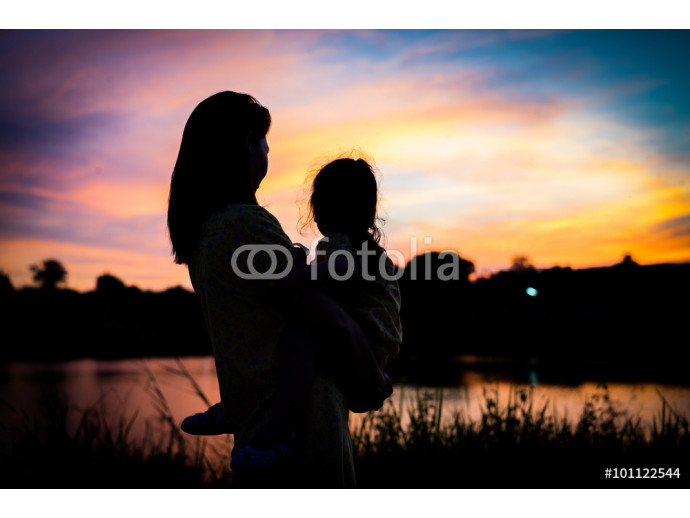 Fototapeta Shadow of Mother holding her daughter to see the sunset silhouet 64238