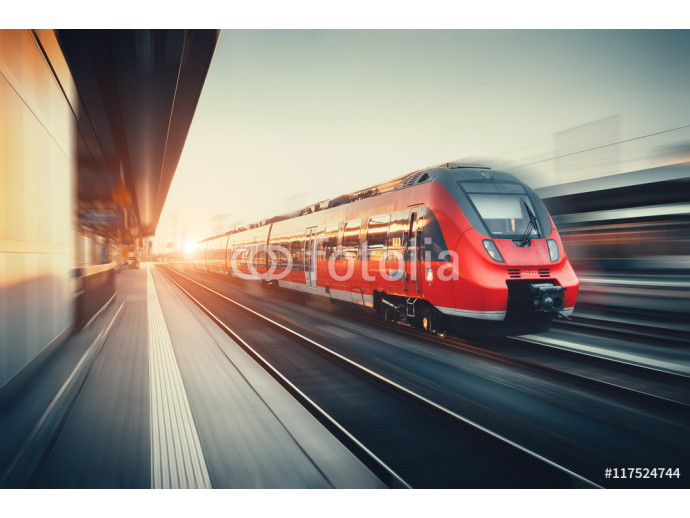 Beautiful railway station with modern red commuter train at suns 64238