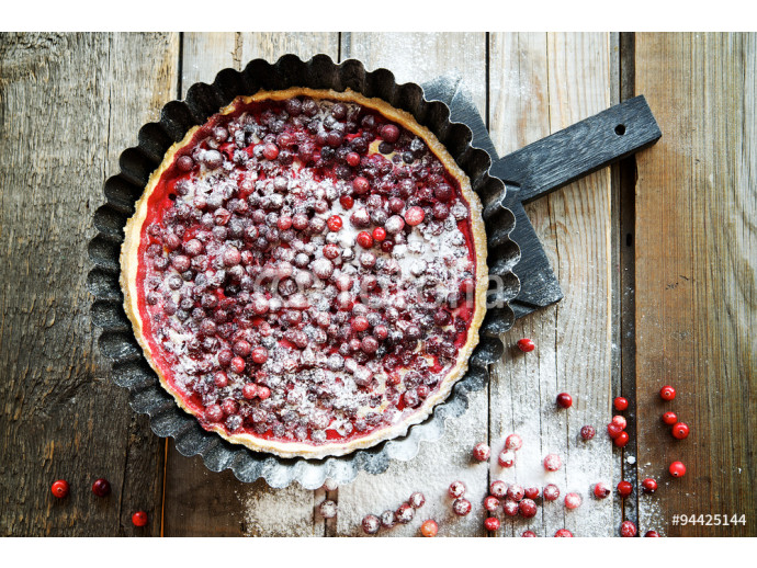 Cranberry cake in the baking dish on a wooden background  64238