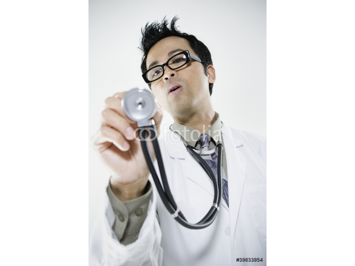 Asian male doctor holding out stethoscope 64238