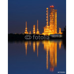 Reflection of gold petrochemical industry on sunset 64238