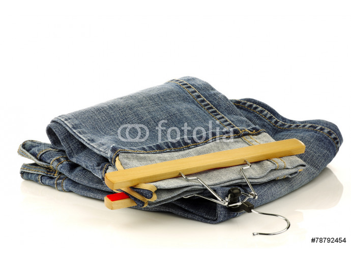 stack of jeans and one with a clothes hanger isolated on a white 64238