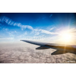 Wing of the plane on blue sky background 64238