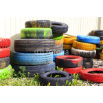 colorful waste tires towers. dump waste of colored tires of different sizes 64238
