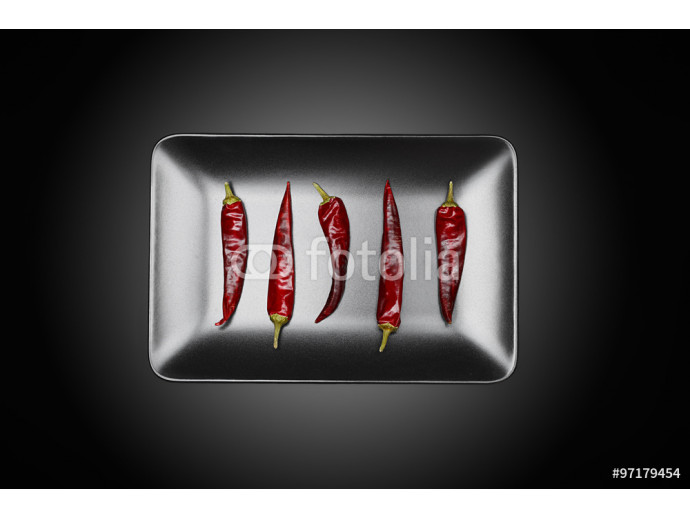 Fototapeta Top View of on a Plate with Chili on a Dark Background 64238