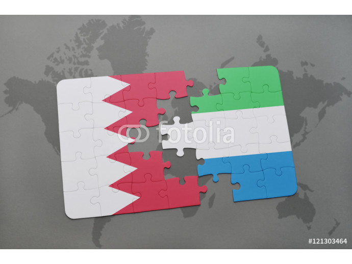 Vliestapete puzzle with the national flag of bahrain and sierra leone on a world map background. 64238