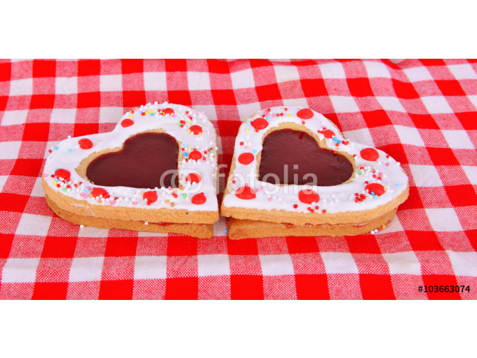 Heart cookies on the red table cloth 64238