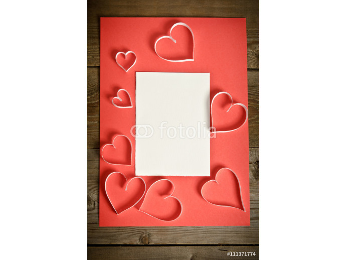 Many hearts of white paper lying on a red background.top view 64238