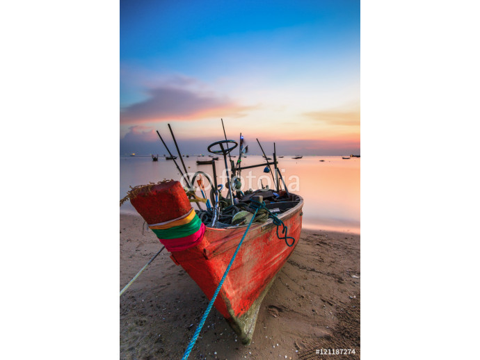 Small fishing boat used as a vehicle for finding fish in the sea.at sunset 64238