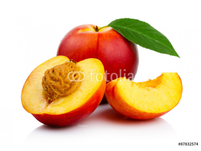 Peach fruits with slice and green leaves isolated 64238