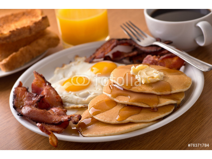 Breakfast with bacon, eggs, pancakes, and toast 64238