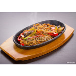 Soba noodles with meal and vegetables over black background 64238