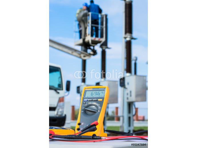 Fototapeta Workers fixing high voltage circuit breaker using truck with aerial platform and instument of measurement 64238